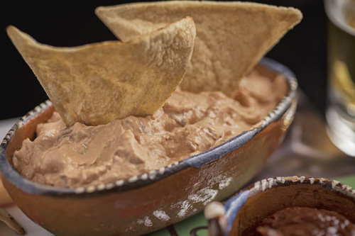 The Chipotle Cream Cheese Dip accompanied with tortilla chips