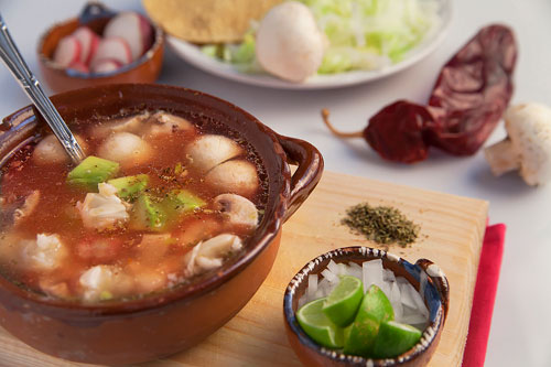 Vegetarian Red Pozole accompanied of many ingredients