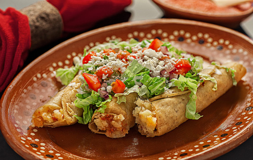 Fried Chorizo and Potato Tacos covered with many fresh ingredients